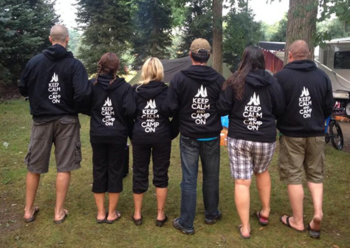A group of campers wearing custom hooded sweatshirts with their custom design.