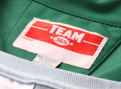 Team 365 custom apparel showing a sewn in custom label for added comfort.