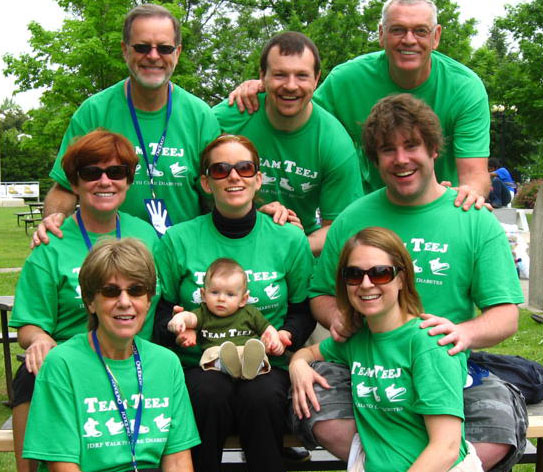 Family wearing bright green printed personalized t-shirts at a charity event.