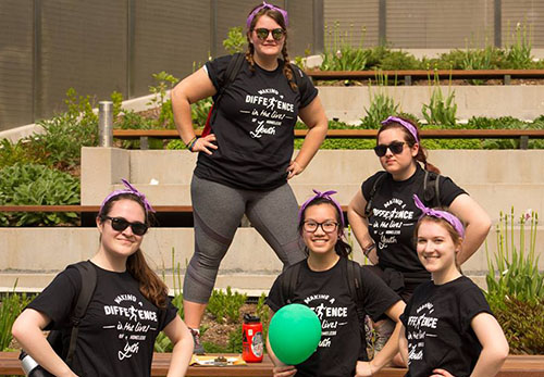 Group of girls displaying the Trek For Teens customized t-shirts in black.