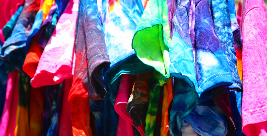 Hung up custom t-shirts with tie dye patterns used to be screen printed with custom logo or design.