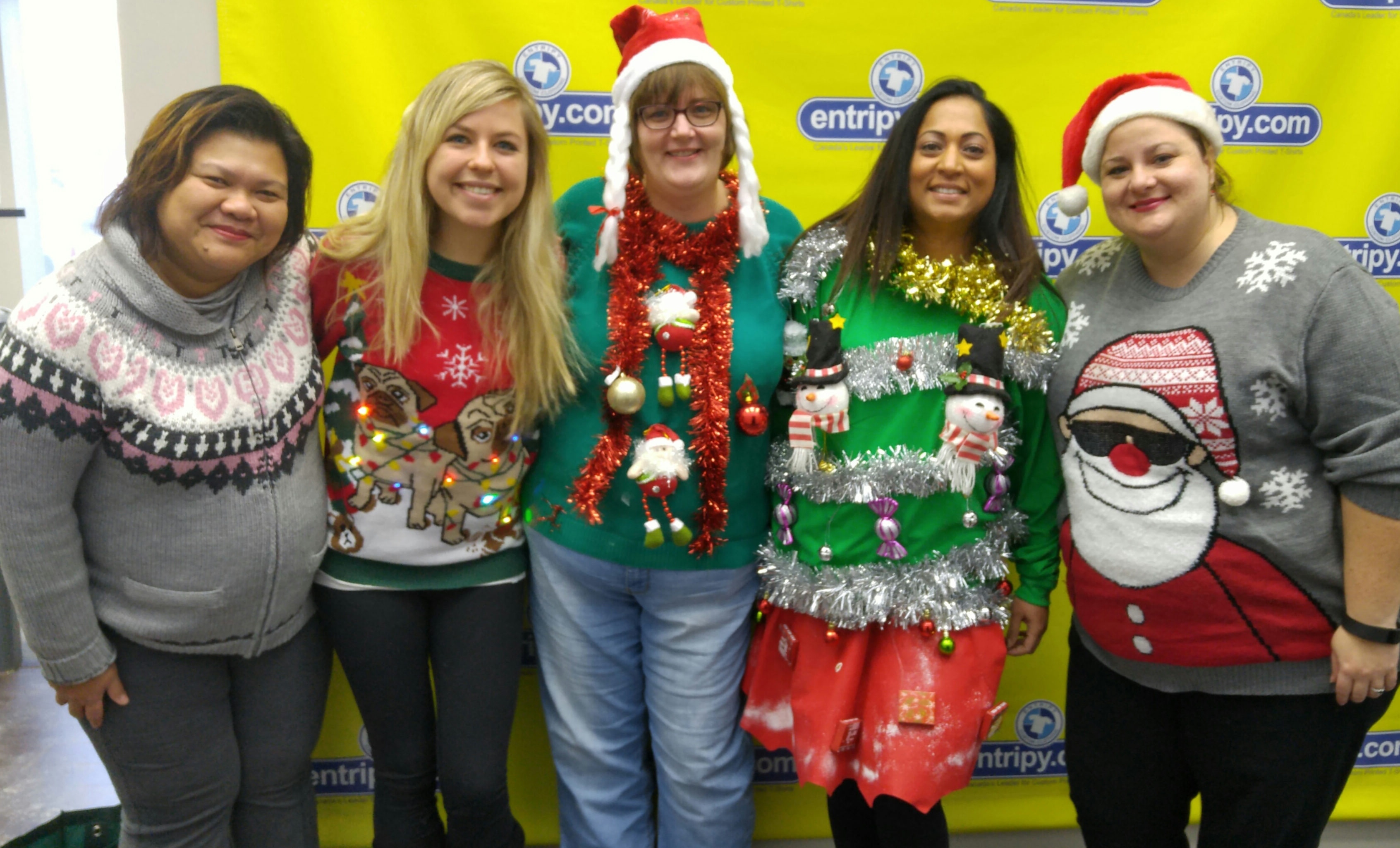 Employees wearing christmas sweaters for the ugly sweater contest.