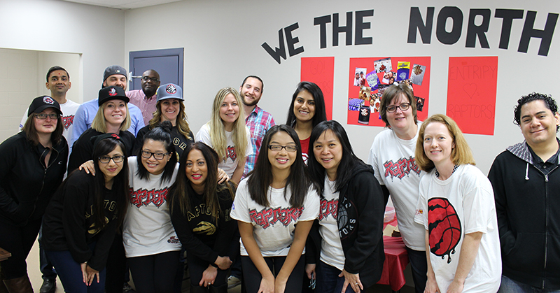 Entripy employees wearing custom t-shirts and custom toques for Raptors playoffs.