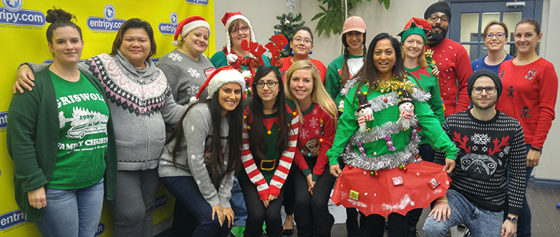Entripy employees wearing christmas sweaters for ugly sweater contest.
