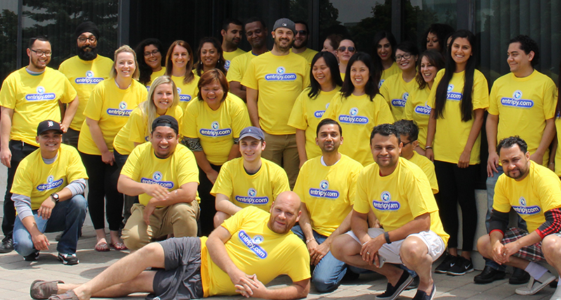 Entripy employees branded in yellow custom t-shirts with entripy logo.