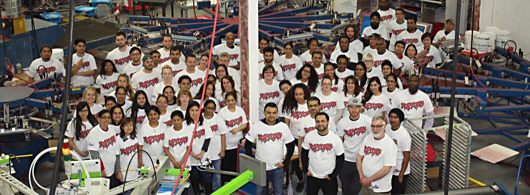 Entripy employees wearing custom printed t-shirts.