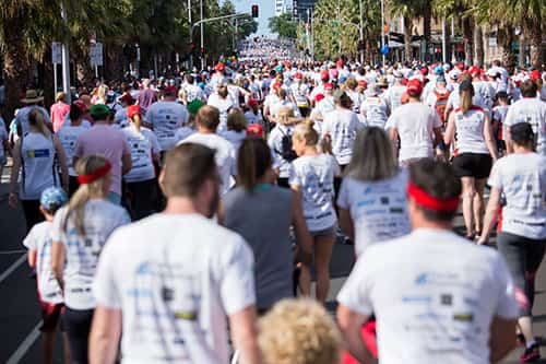 Not-for-profit fundraising walk with custom t-shirts and embroidered hats and sun visors.