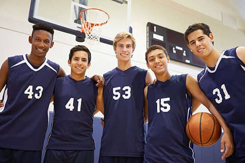 Sports basketball team wearing customized jerseys with personalized numbers.